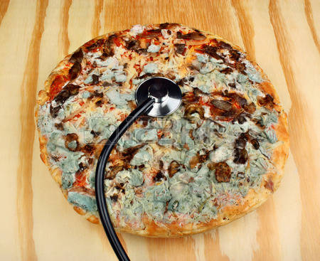 57774155-old-moldy-pizza-and-stethoscope-on-a-wooden-table-food-poisoning